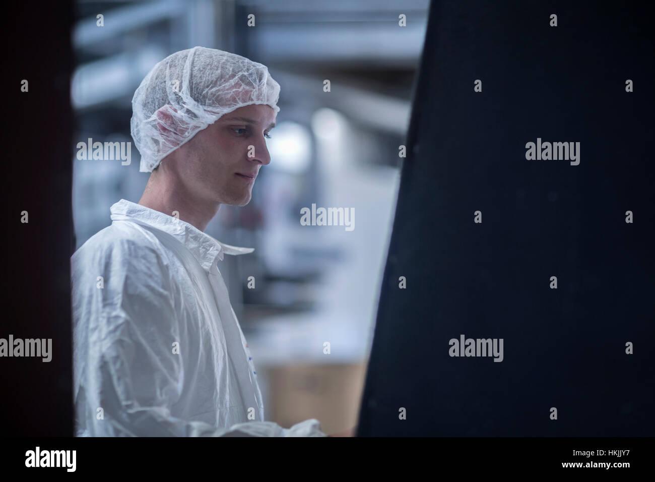 Clean room worker in an industry, Freiburg im Breisgau, Baden-Württemberg, Germany - Stock Image