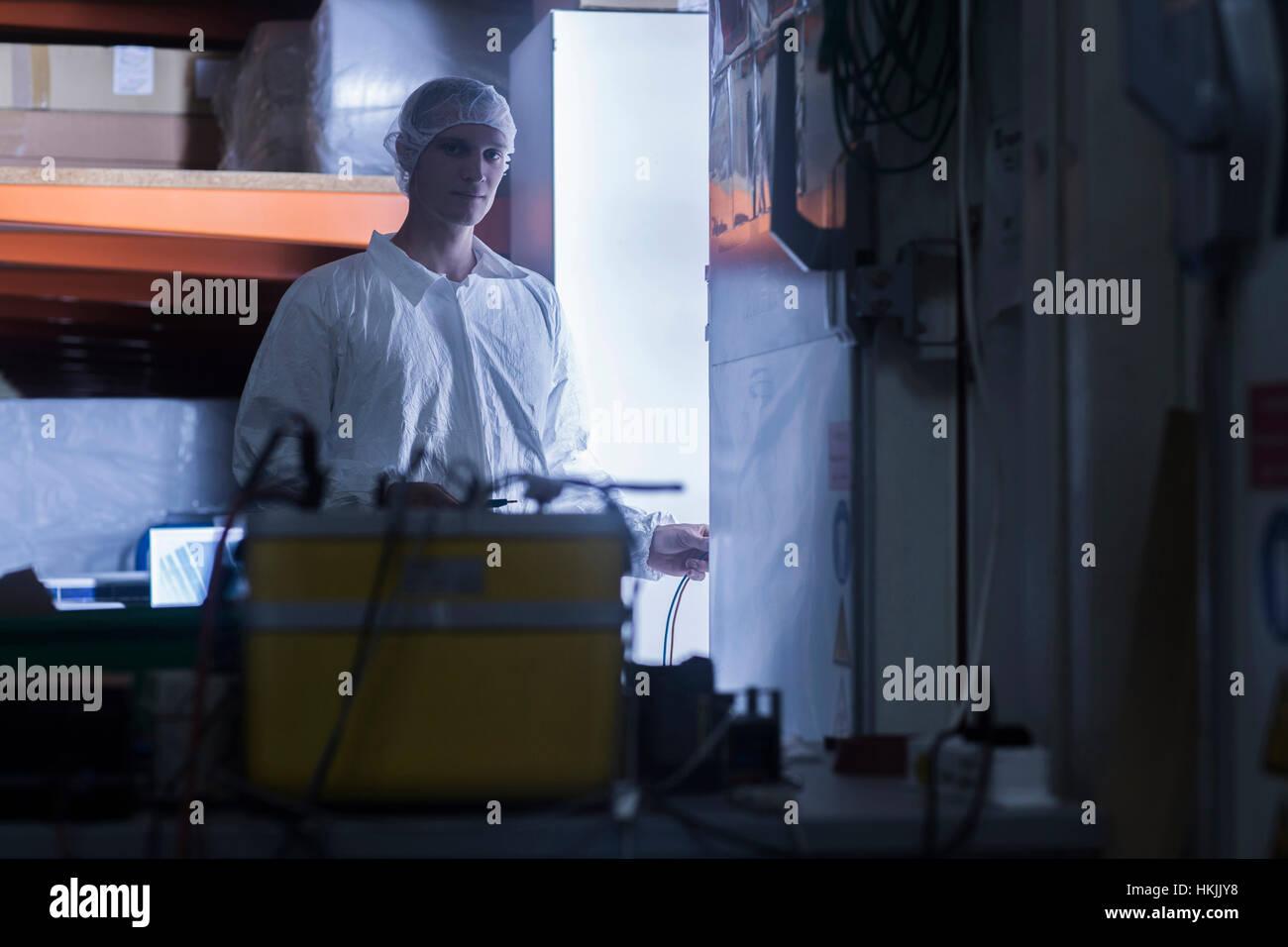 Clean room worker working in warehouse, Freiburg im Breisgau, Baden-Württemberg, Germany - Stock Image