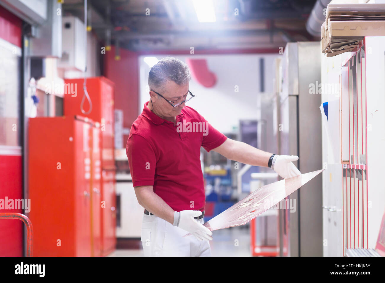 Male engineer examining circuit board in industry,Hanover,Lower Saxony,Germany - Stock Image