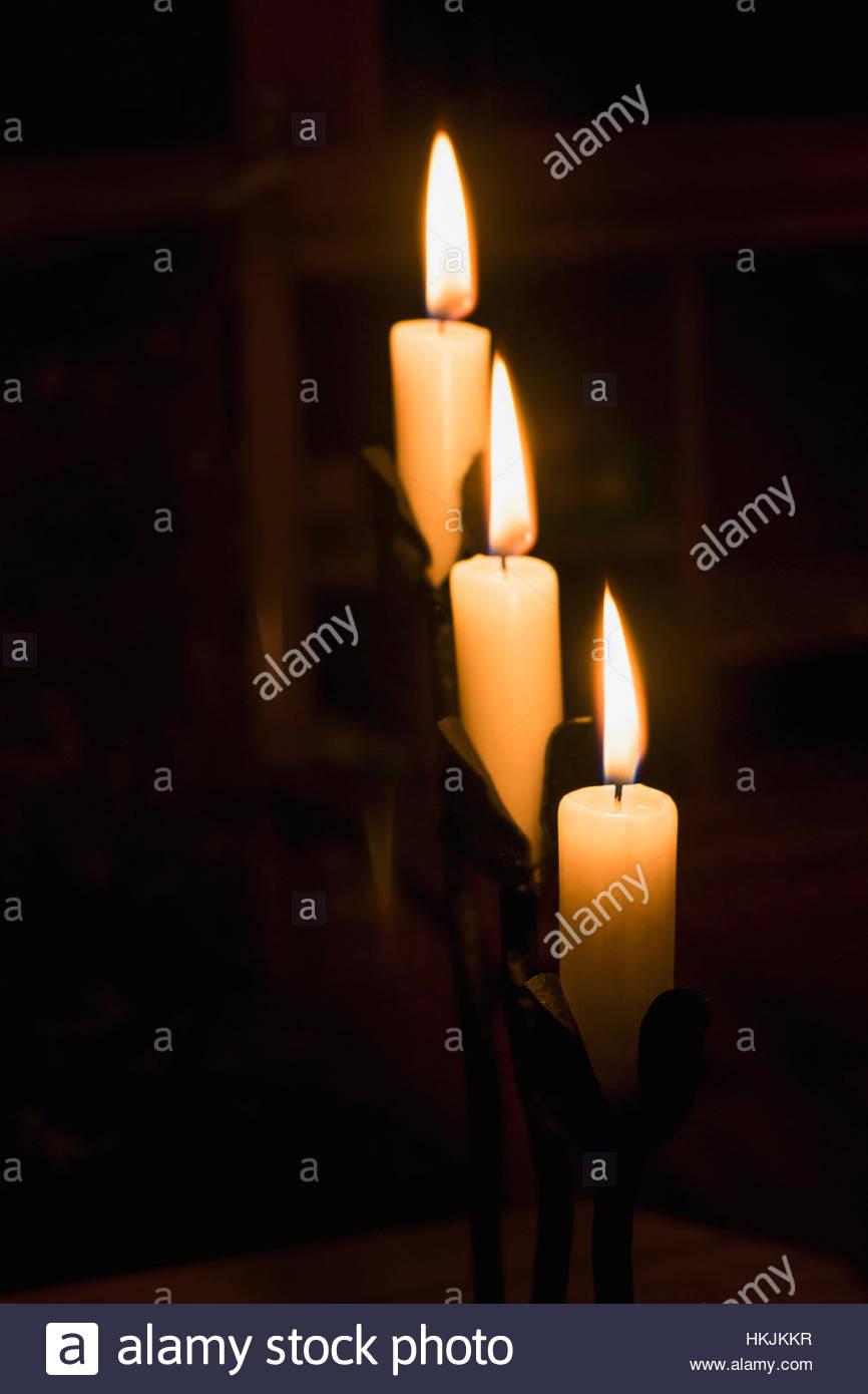 Close-up of three burning candles, Bavaria, Germany - Stock Image