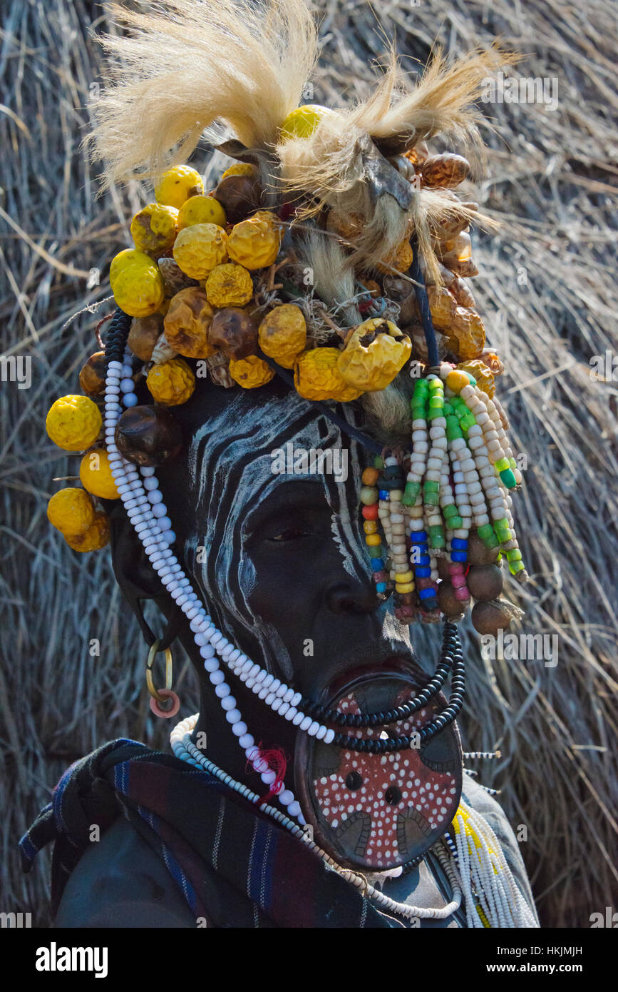 Mursi tribe people with lip plate, Mursi Village, South Omo, Ethiopia - Stock Image