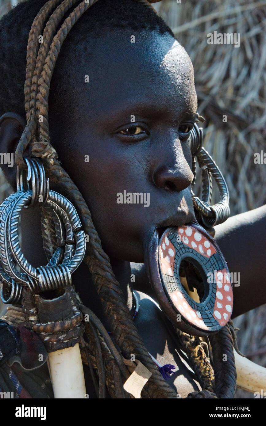Mursi tribe people with lip plate, Mursi Village, South Omo, Ethiopia - Stock Image