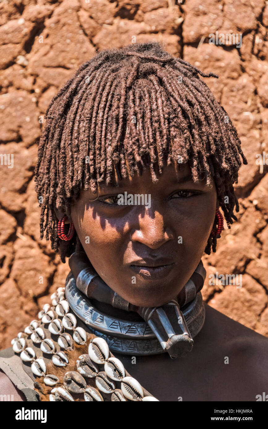 Hamar tribe woman wearing necklace symbol of the first wife, South Omo, Ethiopia - Stock Image