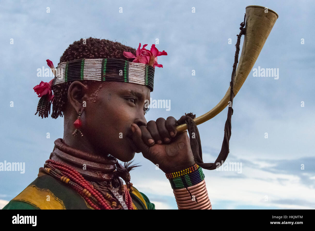 Hamar tribe woman blowing horn in Hamar Village, South Omo, Ethiopia - Stock Image