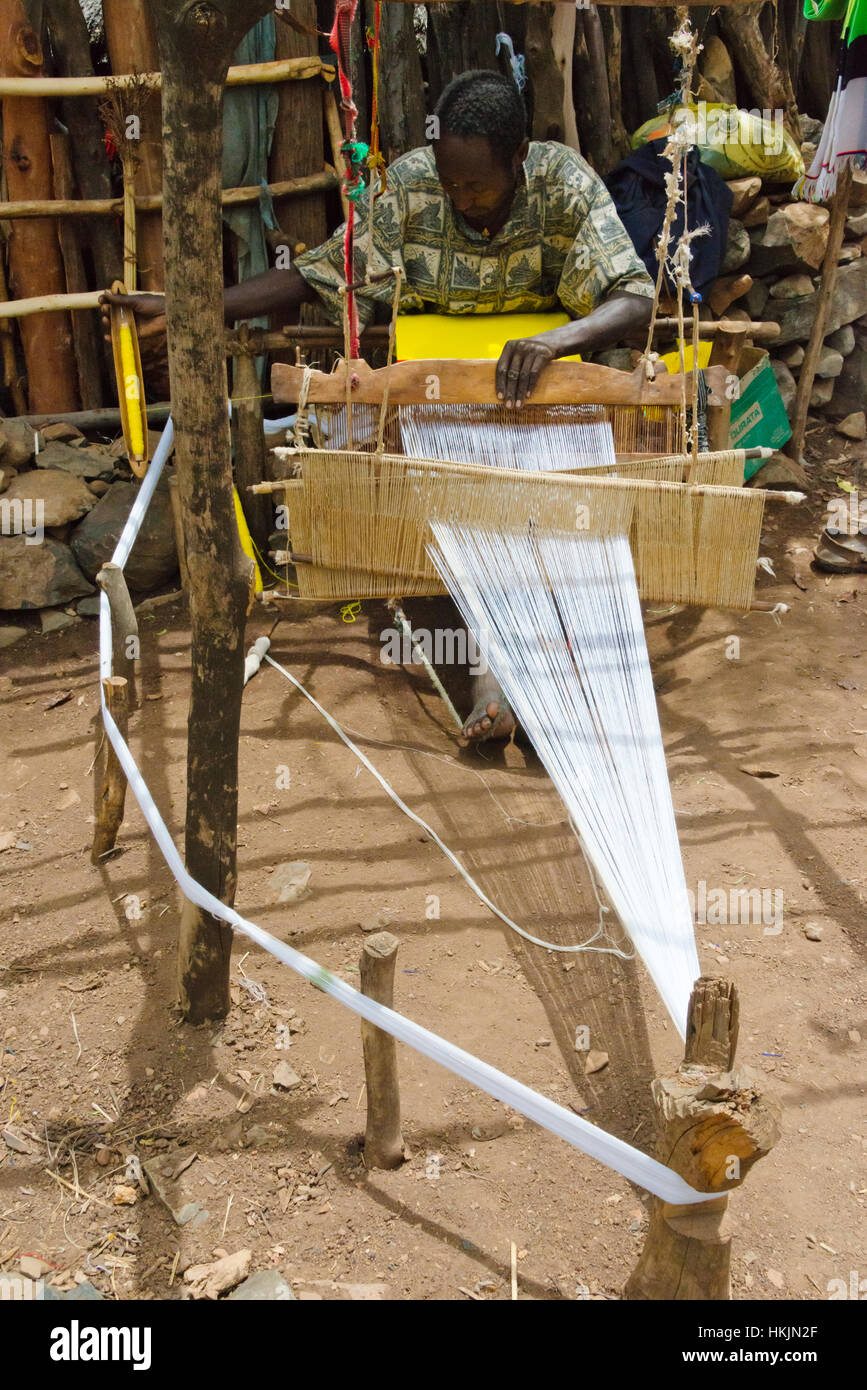 Konso Cultural Landscape (UNESCO World Heritage site), people weaving by loom in the village, Ethiopia Stock Photo