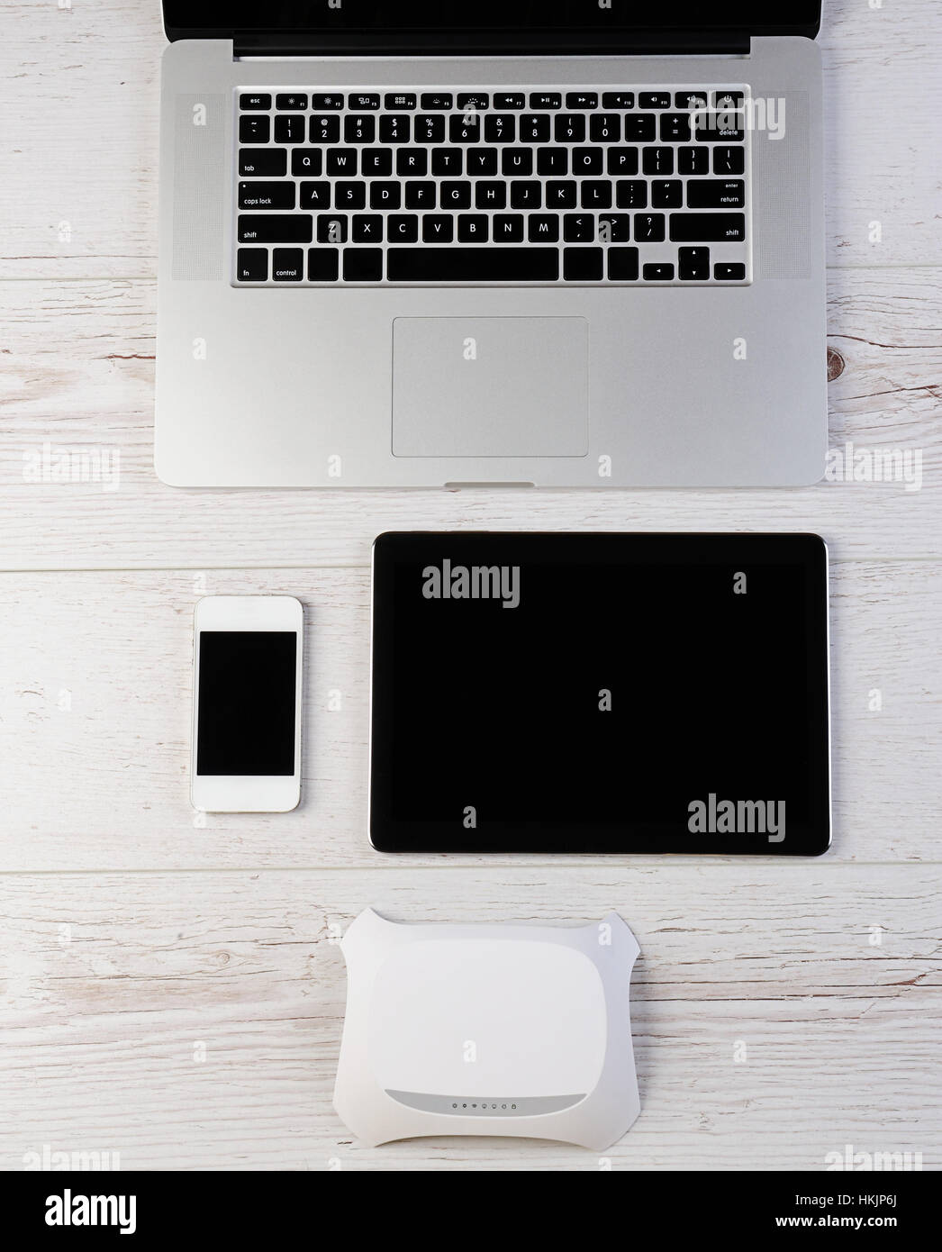 Wifi router modem connect laptop tablet and smartphone on wood stock wifi router modem connect laptop tablet and smartphone on wood greentooth Images