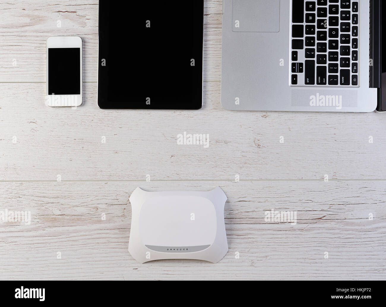 Wifi internet router modem connect laptop tablet and smartphone on wifi internet router modem connect laptop tablet and smartphone on wood greentooth Images