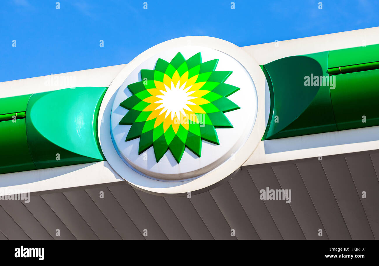 BP - British Petroleum petrol station logo over blue sky. British Petroleum is a British multinational oil and gas Stock Photo
