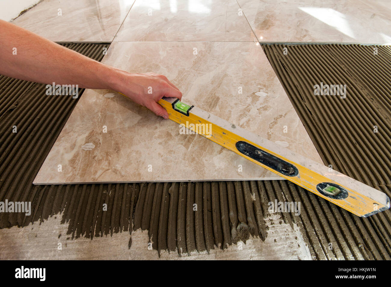 Ceramic tiles and tools for tiler floor tiles installation home ceramic tiles and tools for tiler floor tiles installation home improvement renovation ceramic tile floor adhesive mortar level dailygadgetfo Image collections