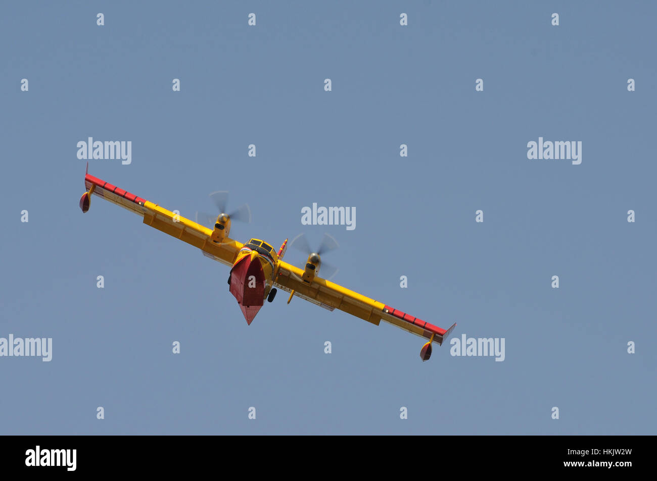 Canadair aircraft water bomber, turbo prop firefighting aircraft in action, shot from front and below, shot from - Stock Image