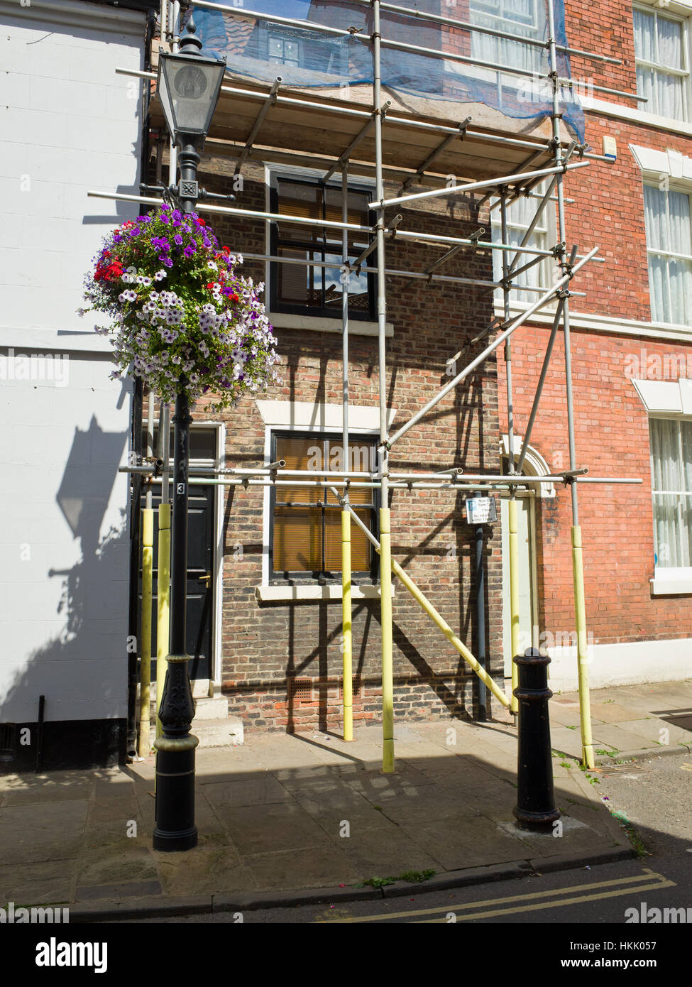 Scaffolding Outside Building Being renovated - Stock Image