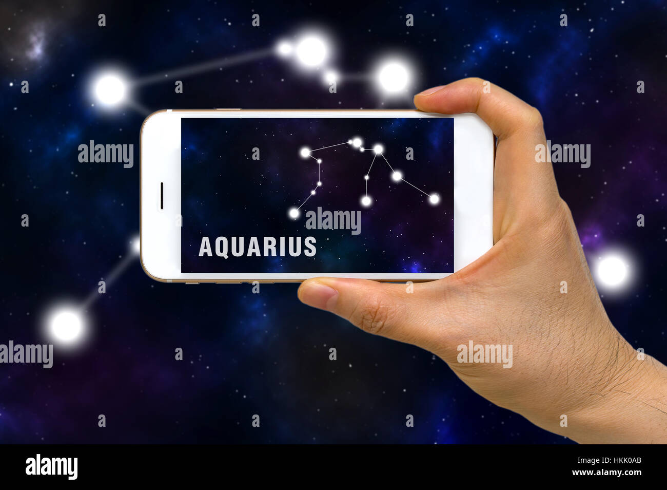 Concept of augmented reality, AR, of Aquarius zodiac constellation app on smartphone. - Stock Image