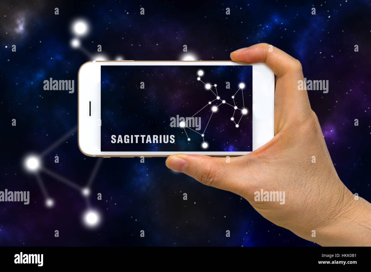 Concept of augmented reality, AR, of Sagittarius zodiac constellation app on smartphone. Stock Photo