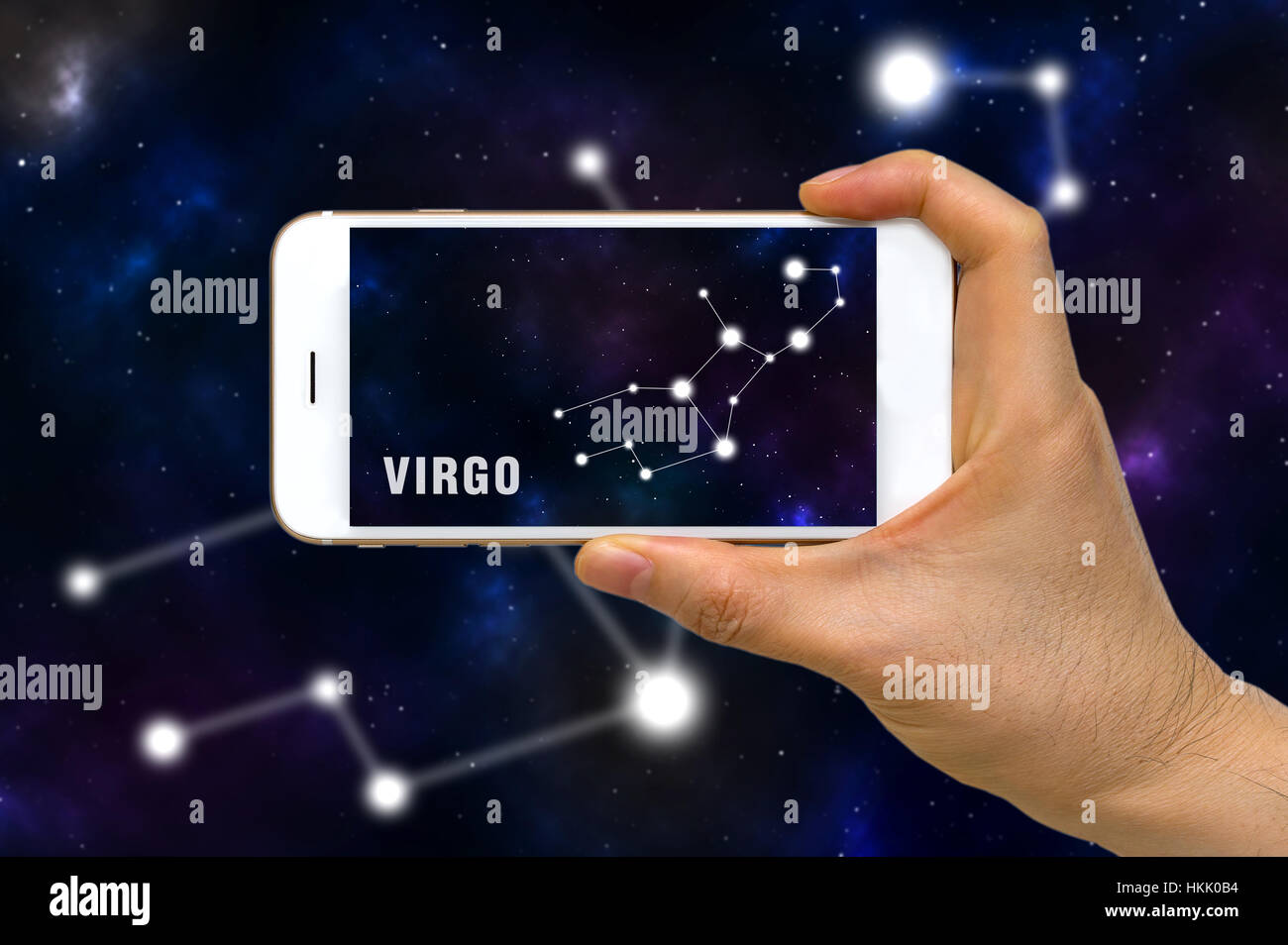 Concept of augmented reality, AR, of Virgo zodiac constellation app on smartphone. Stock Photo