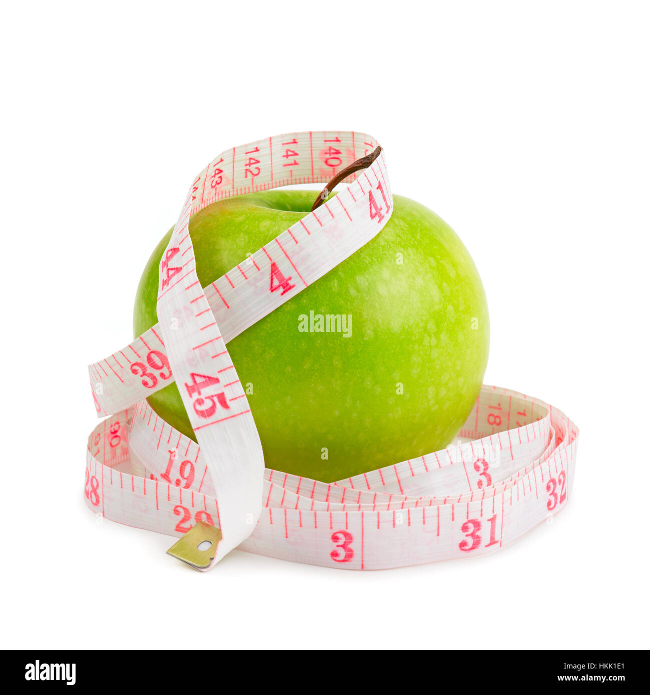 red apple and measure tape isolated on white - Stock Image