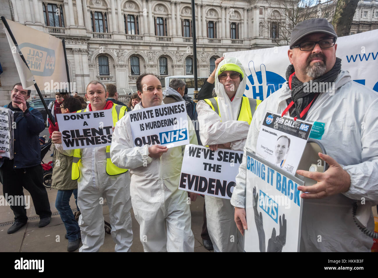 London, UK. 28th January, 2017. Protesters in white suits hold posters at the rally at the Dept of Health. The Sustainability - Stock Image