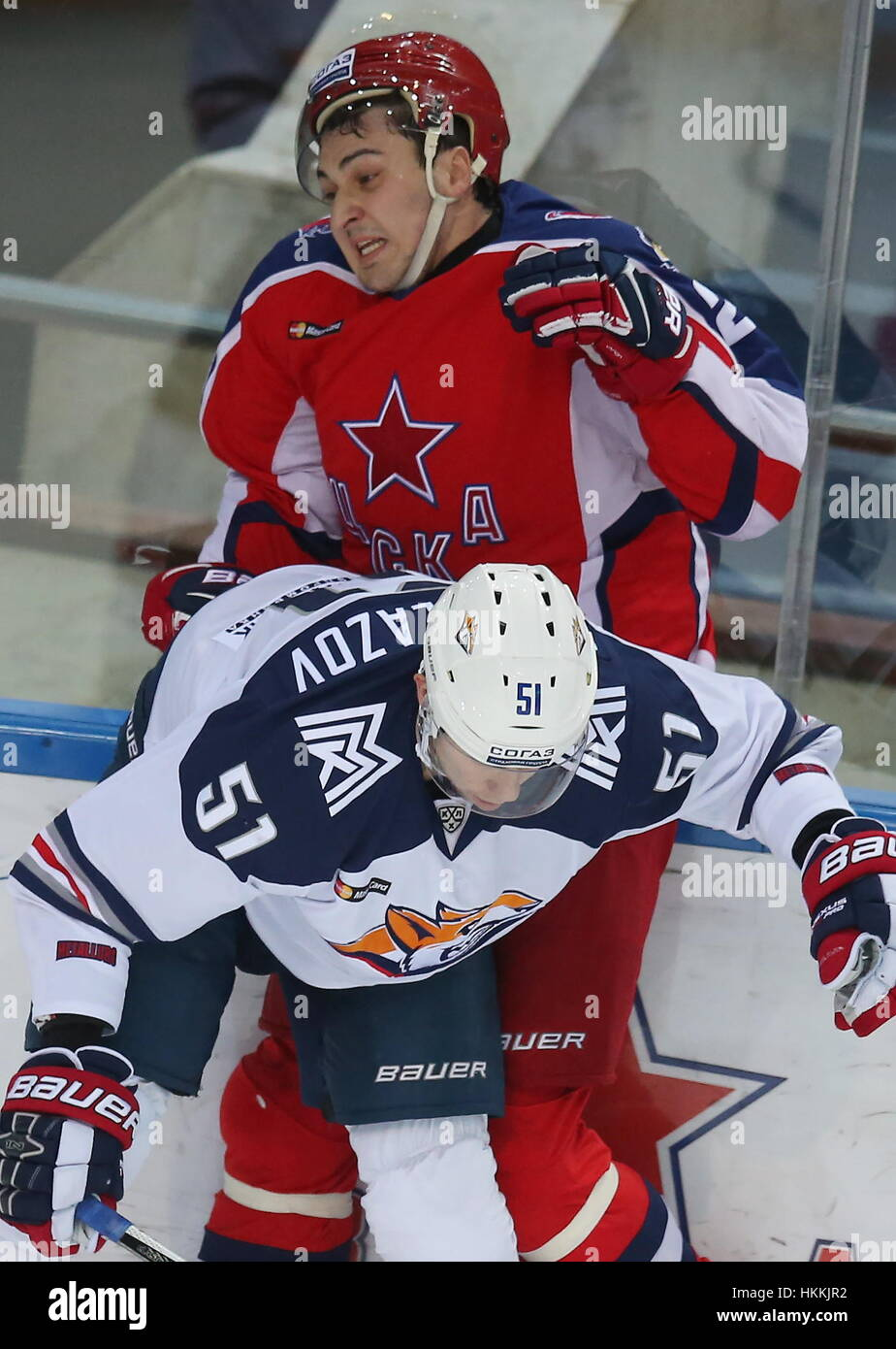 Moscow, Russia. 29th Jan, 2017. Metallurg Magnitogorsk's Alexei Bereglazov (front) and CSKA Moscow's Kirill - Stock Image