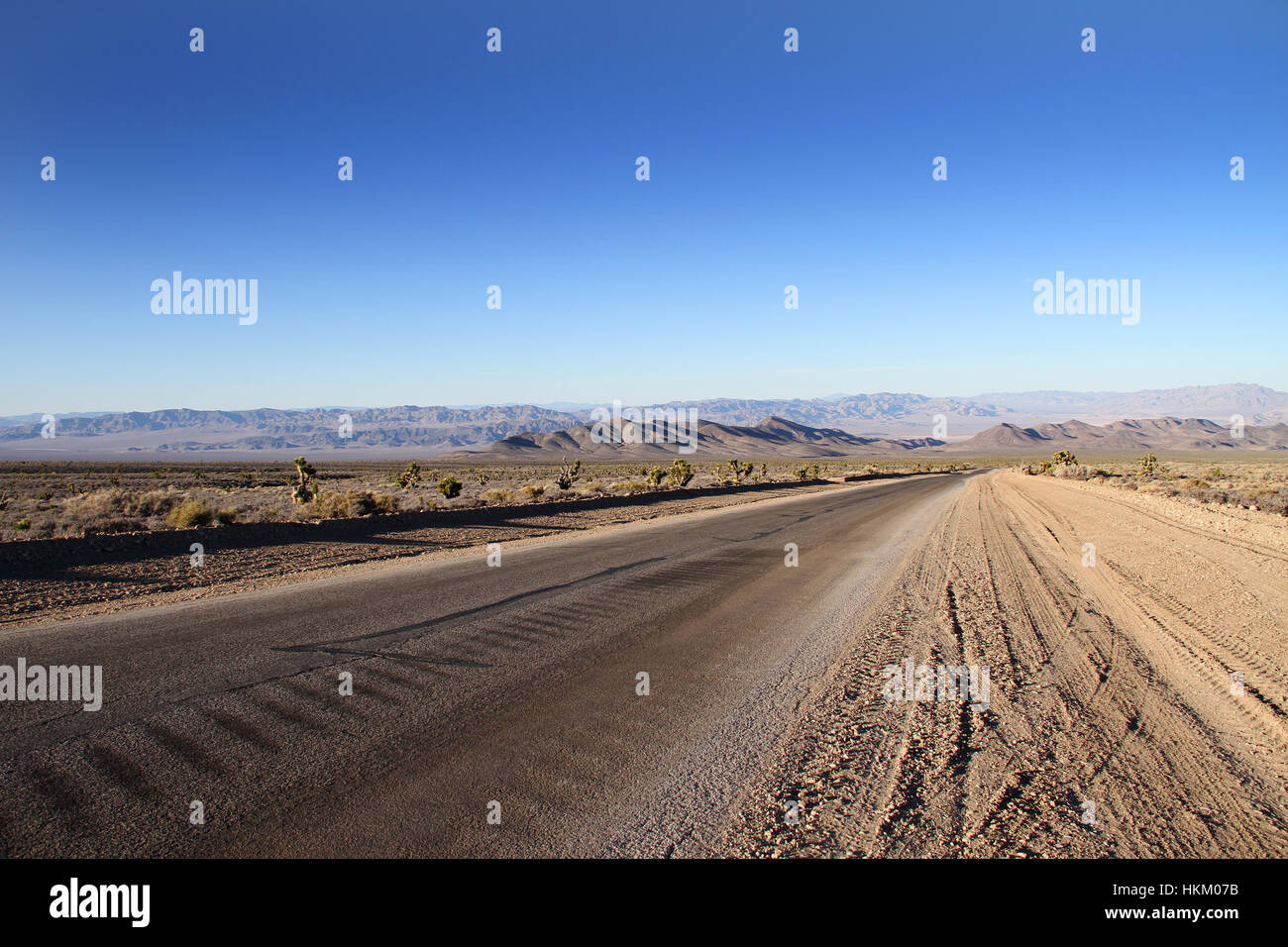 A desolate road in the Nevada desert. - Stock Image
