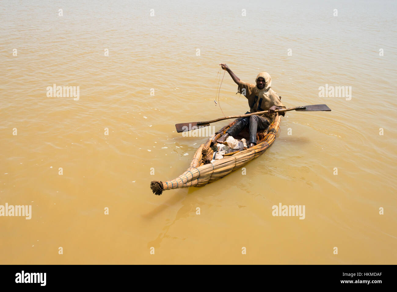 Fisherman on canoe made of papyrus plant, Lake Tana, Bahir Dar, Ethiopia - Stock Image