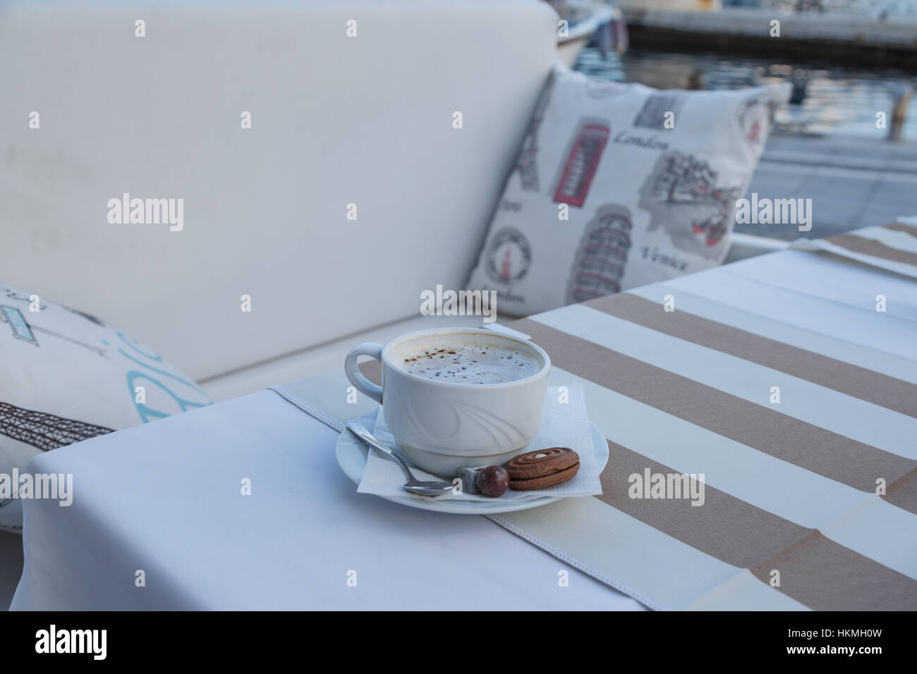 Coffee on the table near the seaside. - Stock Image