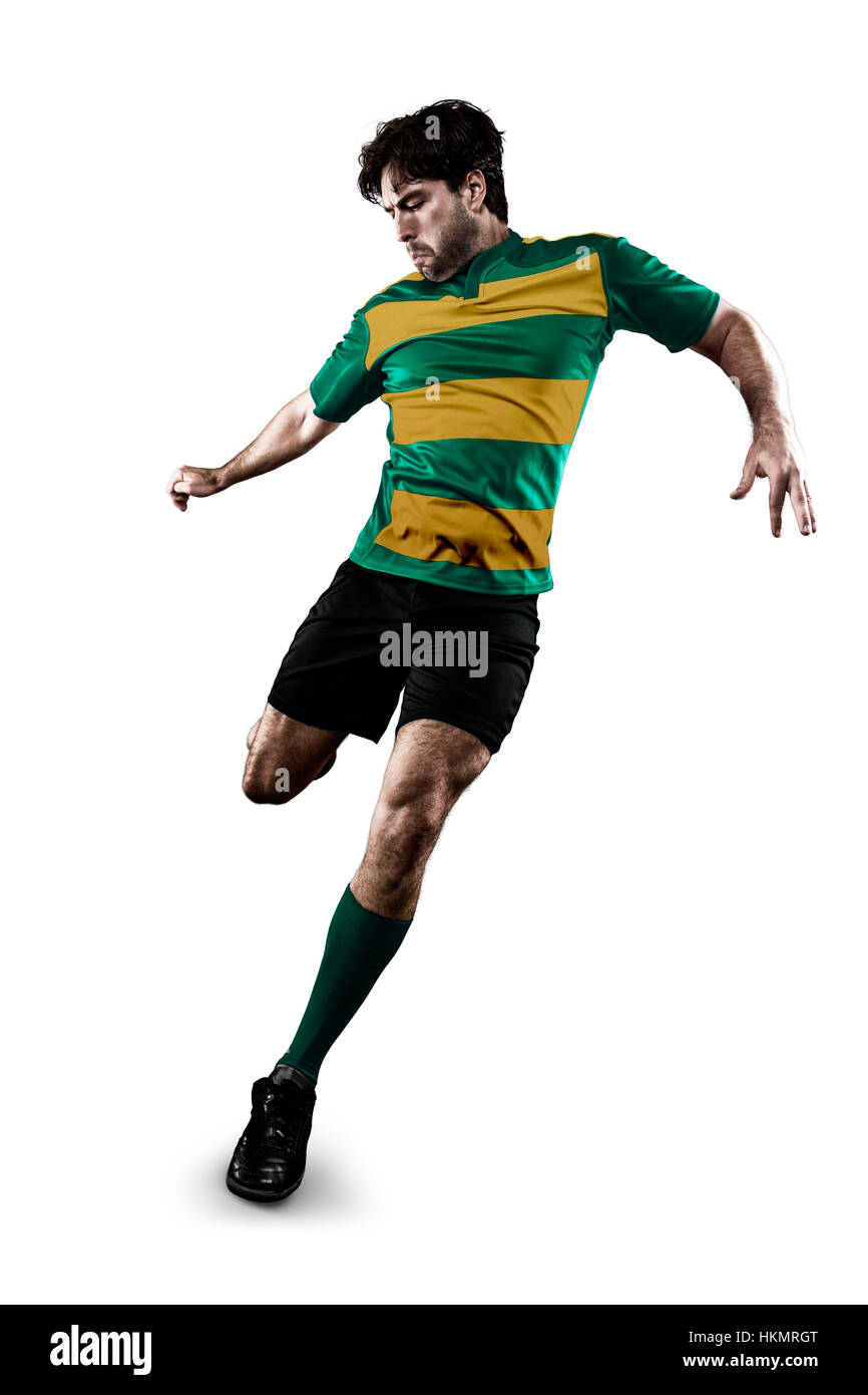 Rugby player in a green and gold uniform kicking. White Background Stock Photo