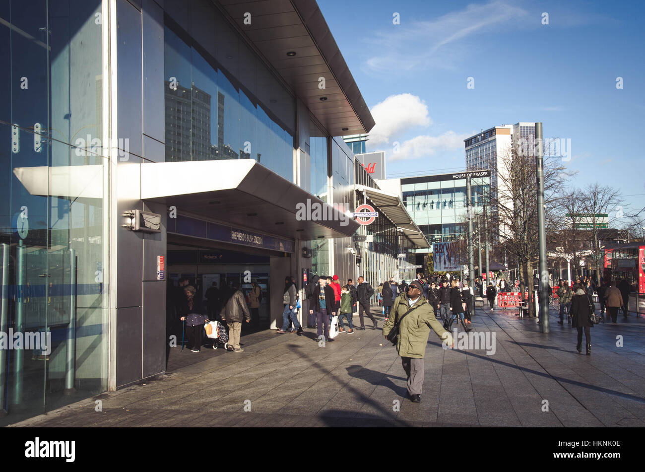 looking at the entrance to Shepherds Bush tube station in the foreground with Westfield Shopping Centre in the background, Stock Photo