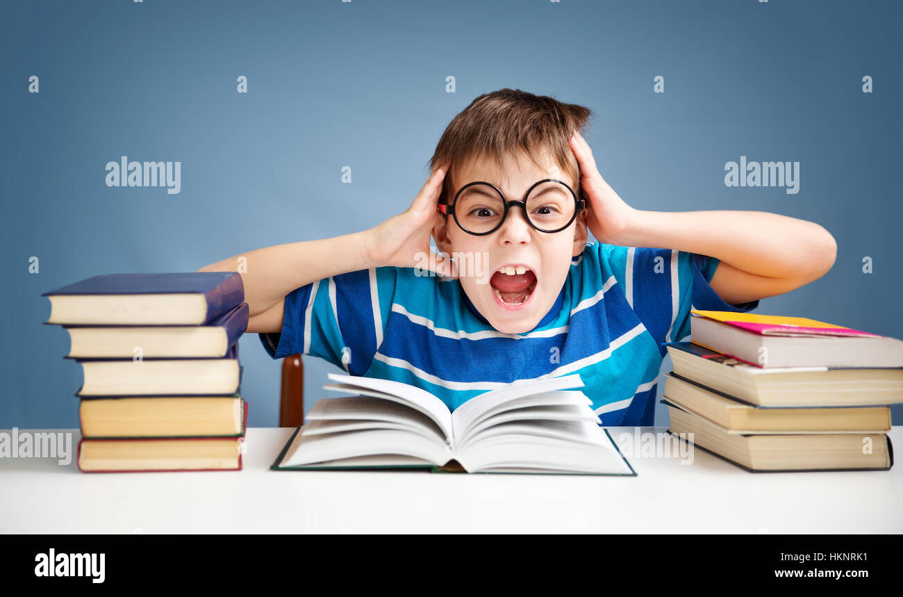 seven years old child reading a book - Stock Image