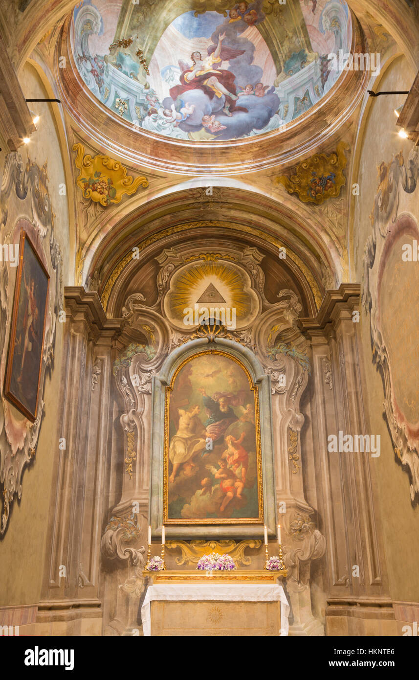 BRESCIA, ITALY - MAY 22, 2016: The the side chapel wih the painting of Holy Trinity in church in church Chiesa di - Stock Image
