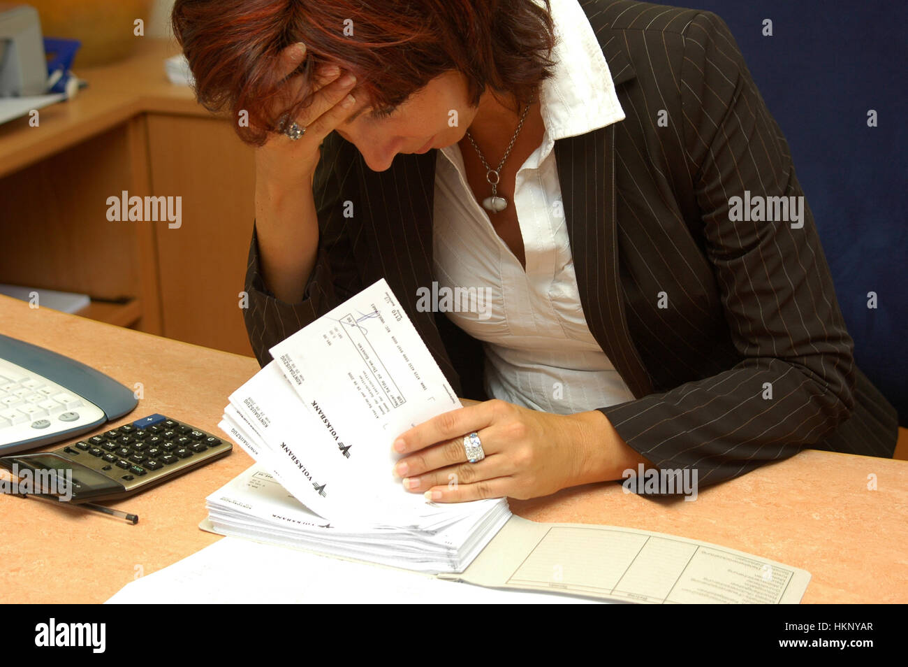 Young woman with money troubles - Stock Image