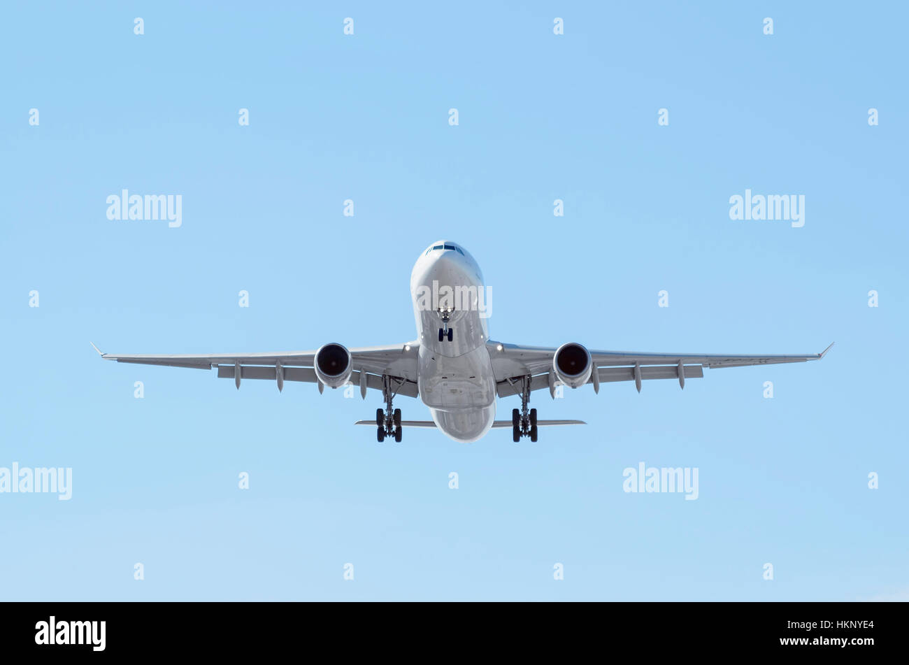 Airplane Airbus A330, of Iberia airline. Blue sky. Front view - Stock Image
