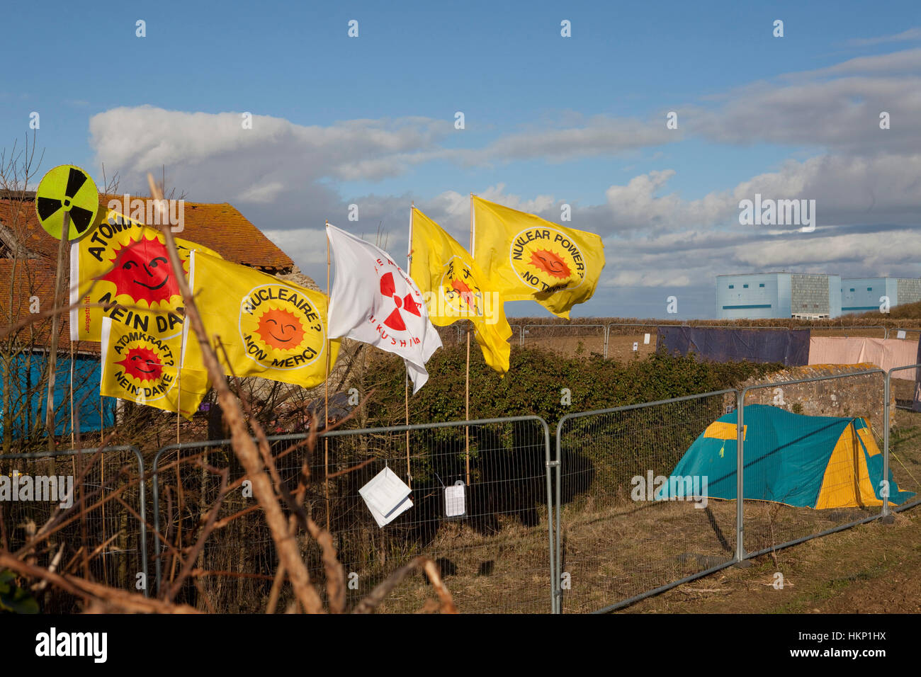 Flags at Anti nuclear protest at Hinkley Point north Somerset . Protesters have occupied a  farmhouse as EDF clear - Stock Image