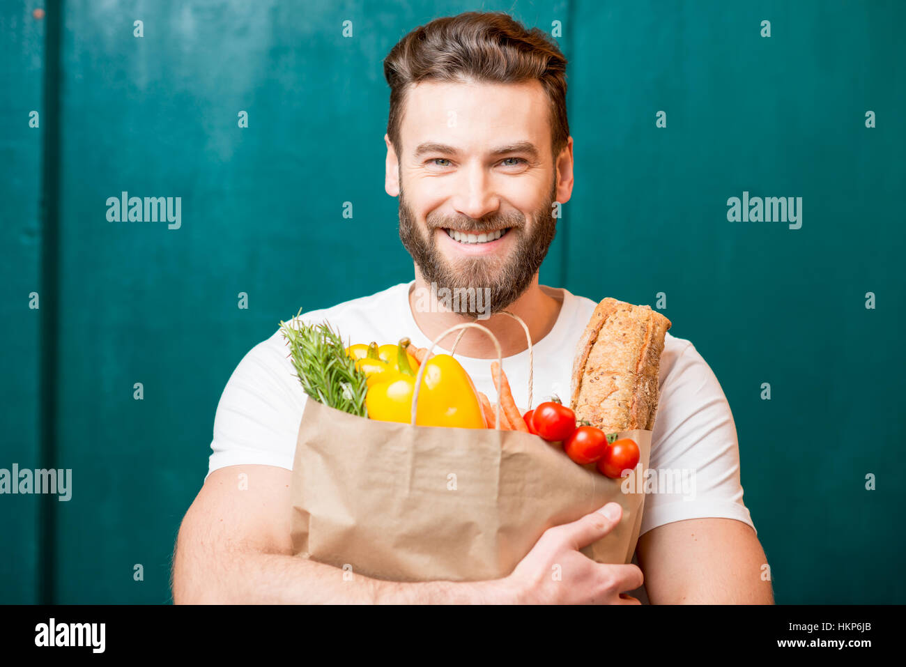 Man with bag full of food - Stock Image
