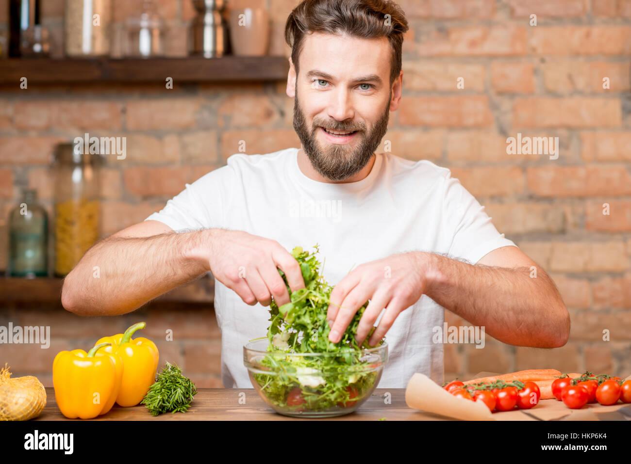 Man making salad - Stock Image
