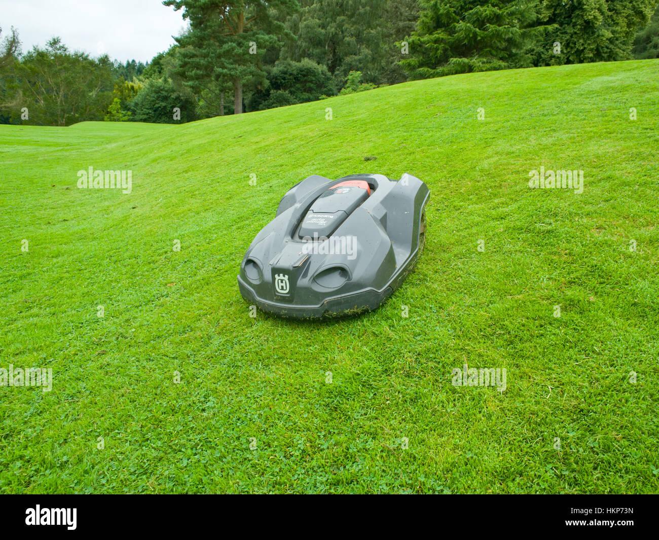 Husqvarna automower cutting lawn Stock Photo