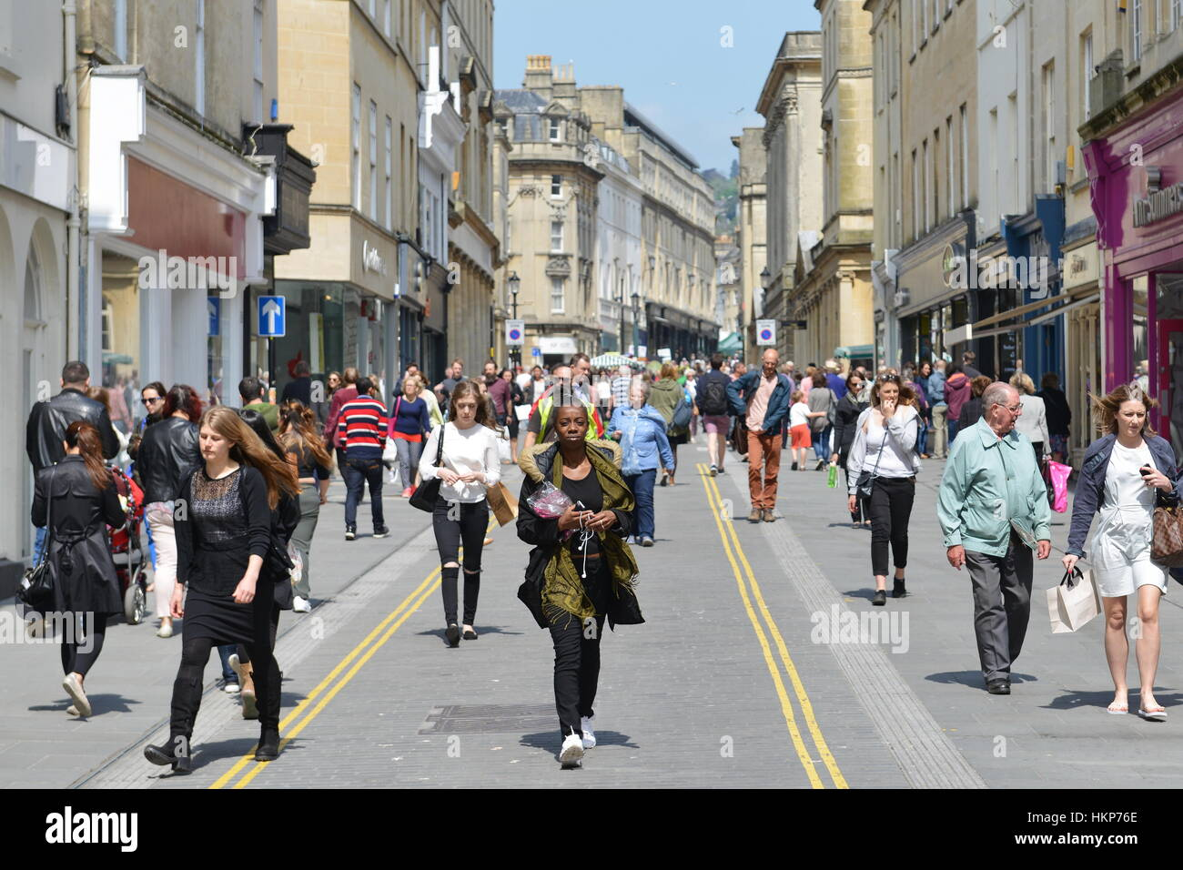 Bath, UK - May 13, 2016: People walk on a city centre street. The Somerset city is a popular for its shopping and Stock Photo