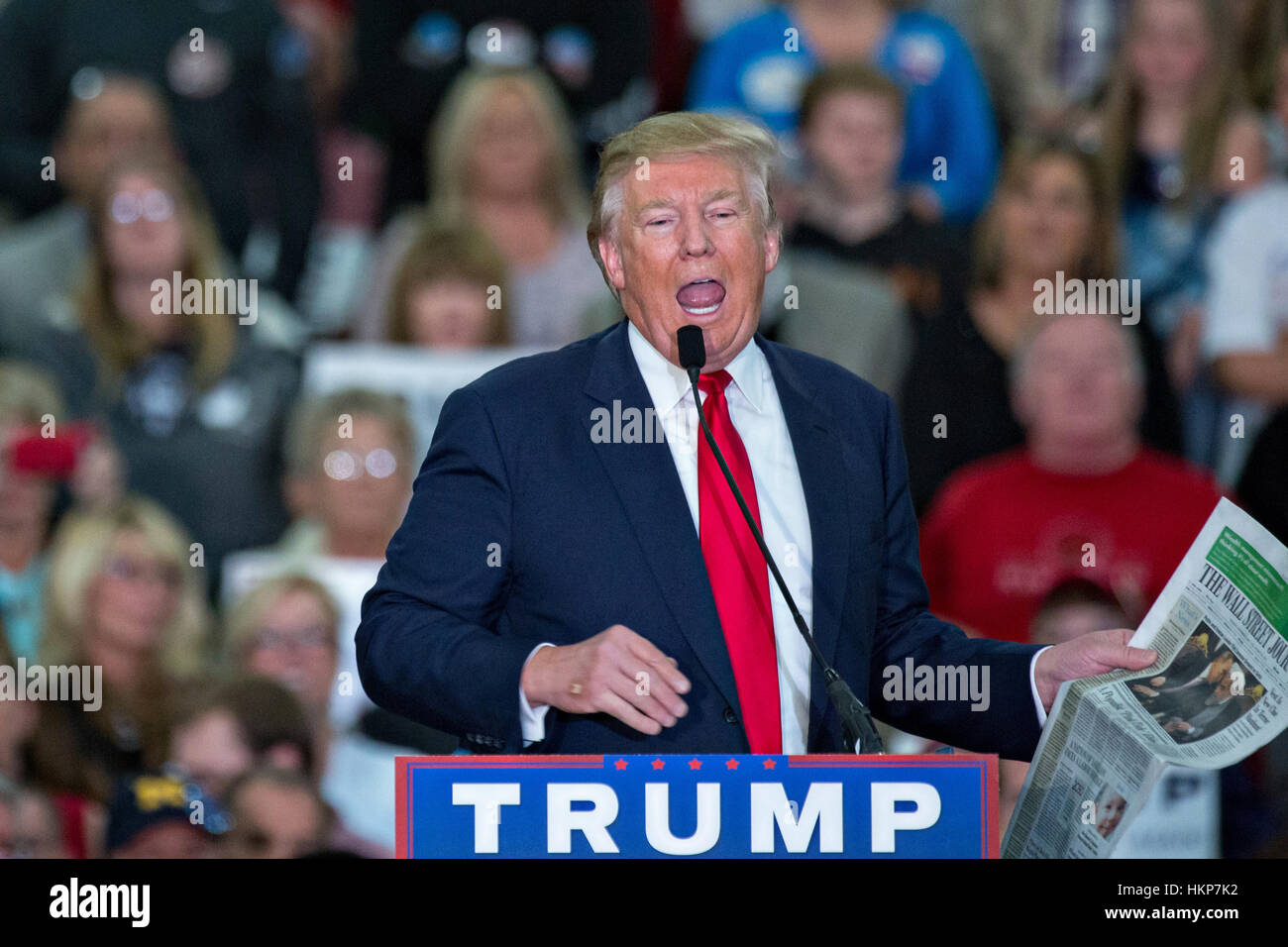 d5fcaaa189e Republican presidential candidate billionaire Donald Trump holds up a copy  of the Wall Street Journal as