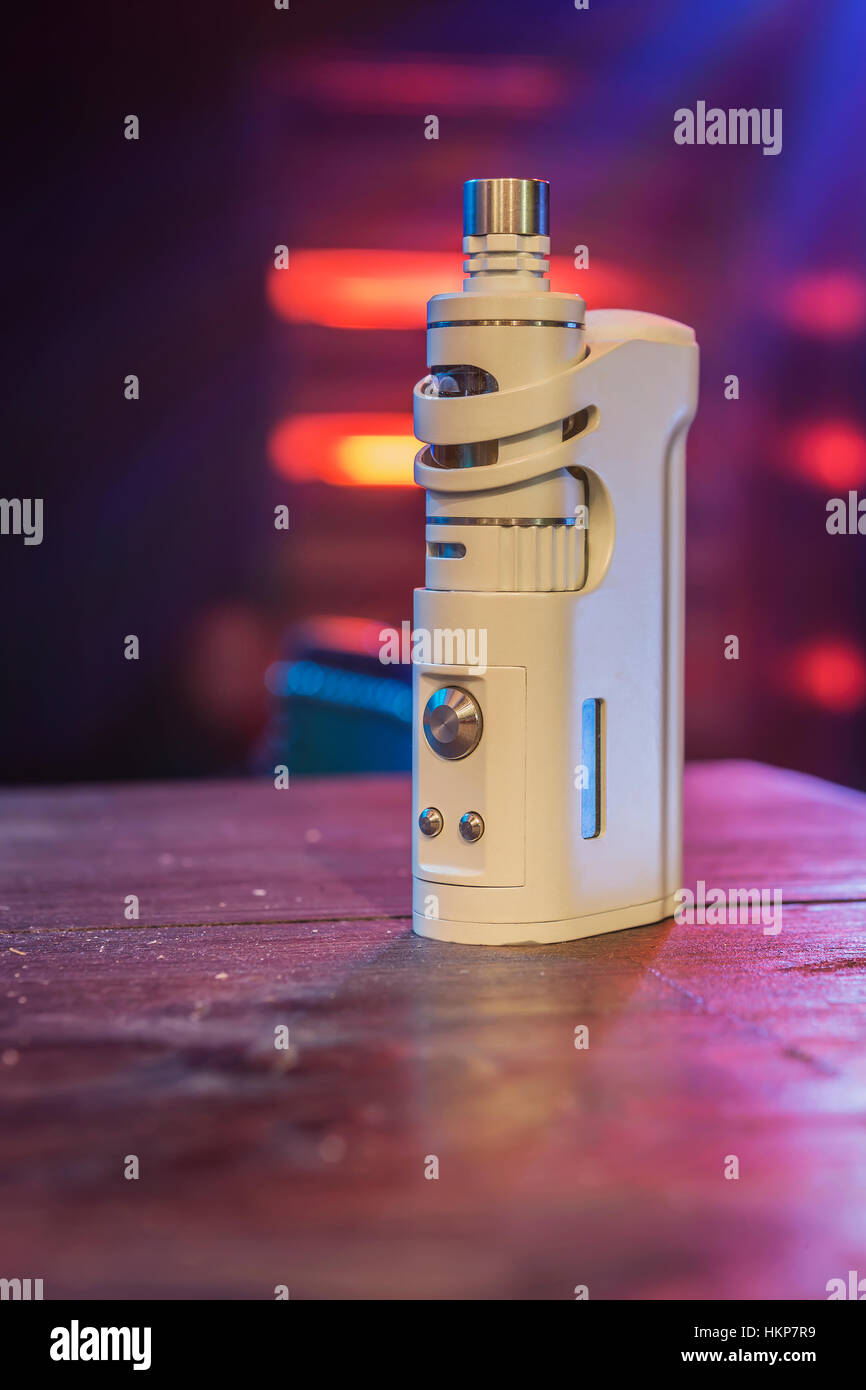 Electronic cigarette at the bar. - Stock Image