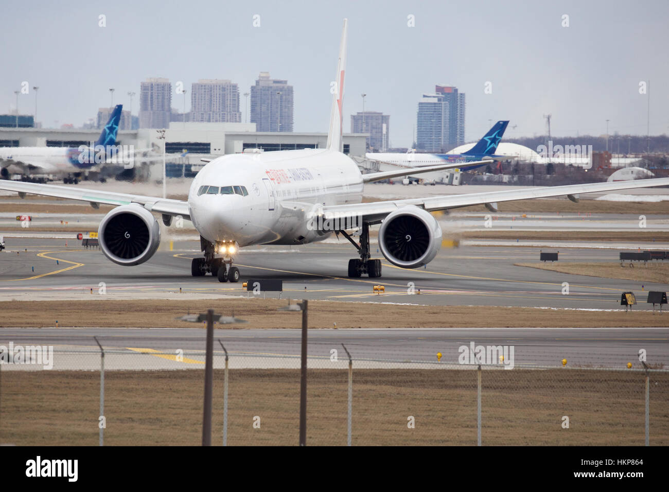 China Eastern Airline Boeing 777 Taxiing to Runway 23L at Toronto Pearson Airport - Stock Image