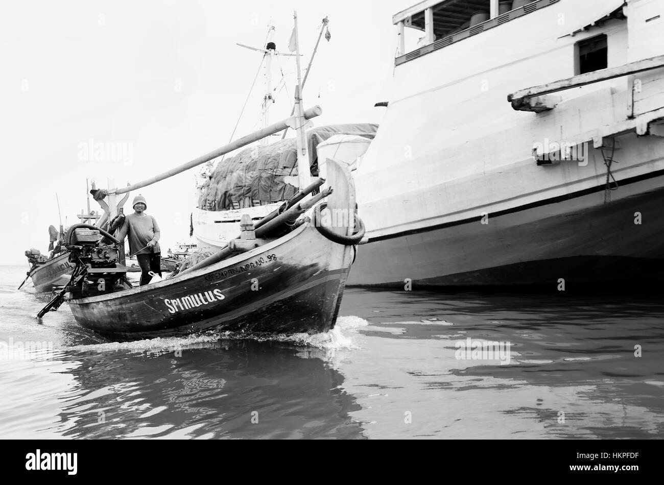 fisherman in the boat at Sunda Kelapa harbour - Stock Image