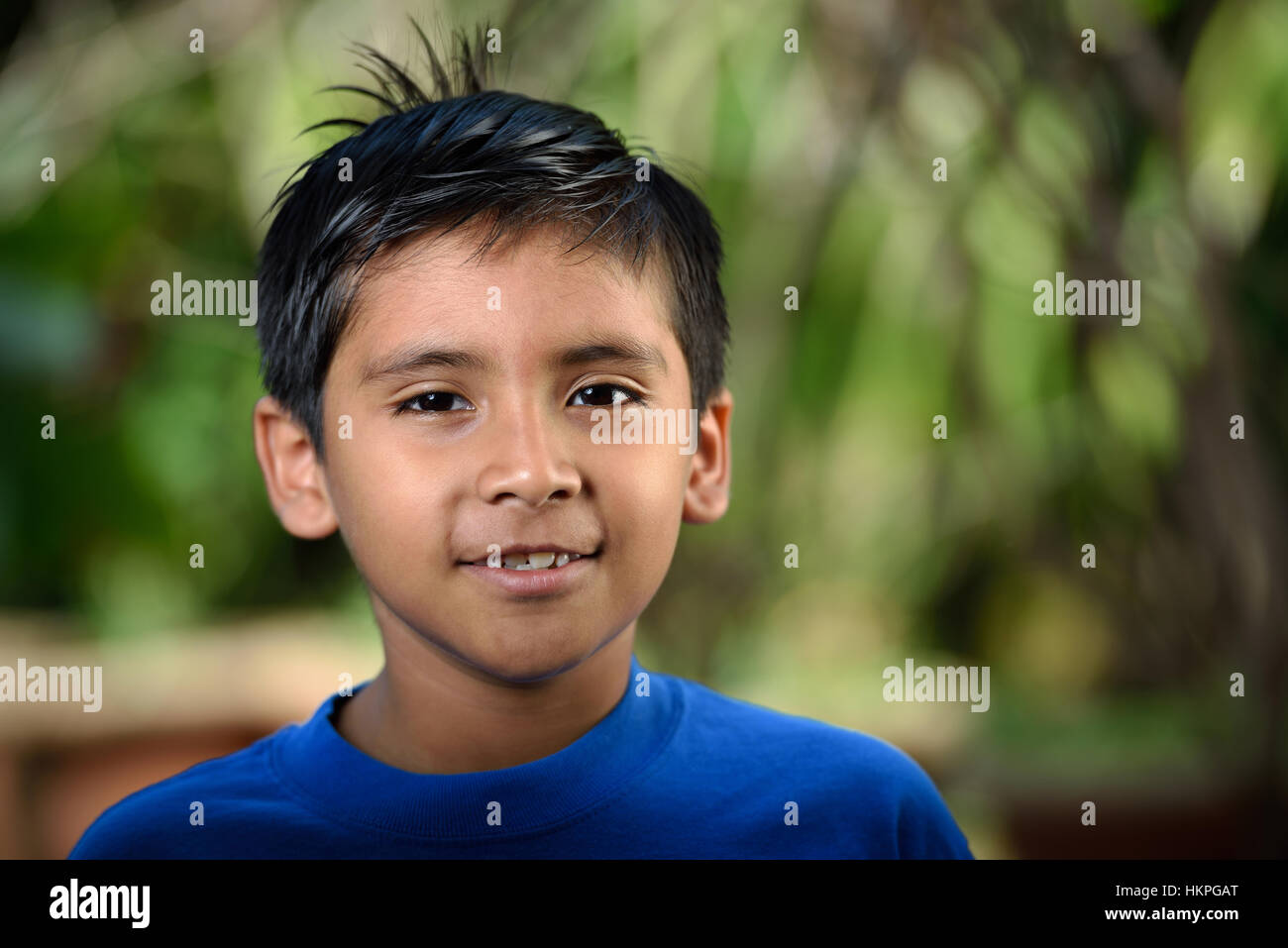 headshot of latino boy with smile in nature stock photo 132646832