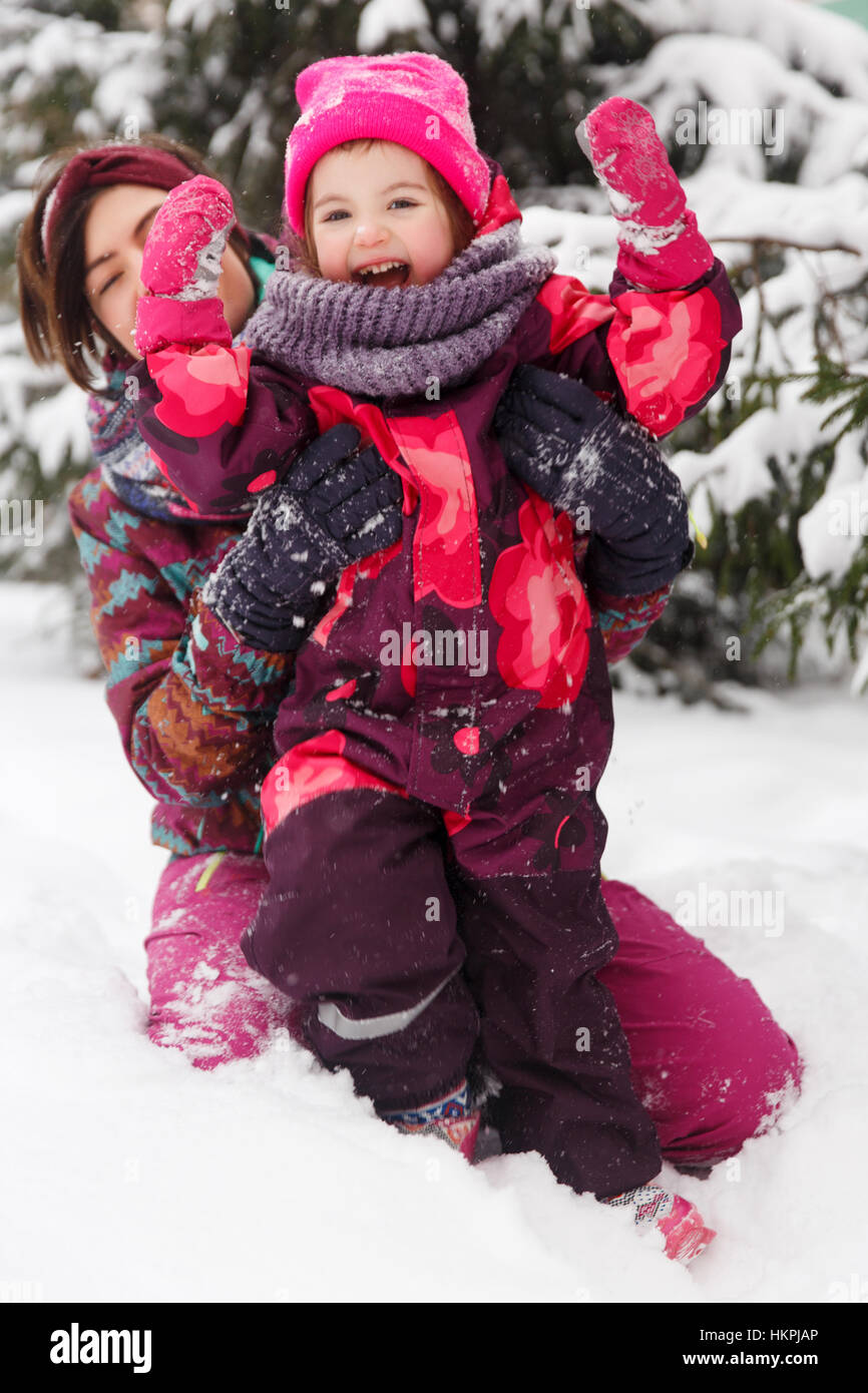 Mother, daughter in winter costumes - Stock Image
