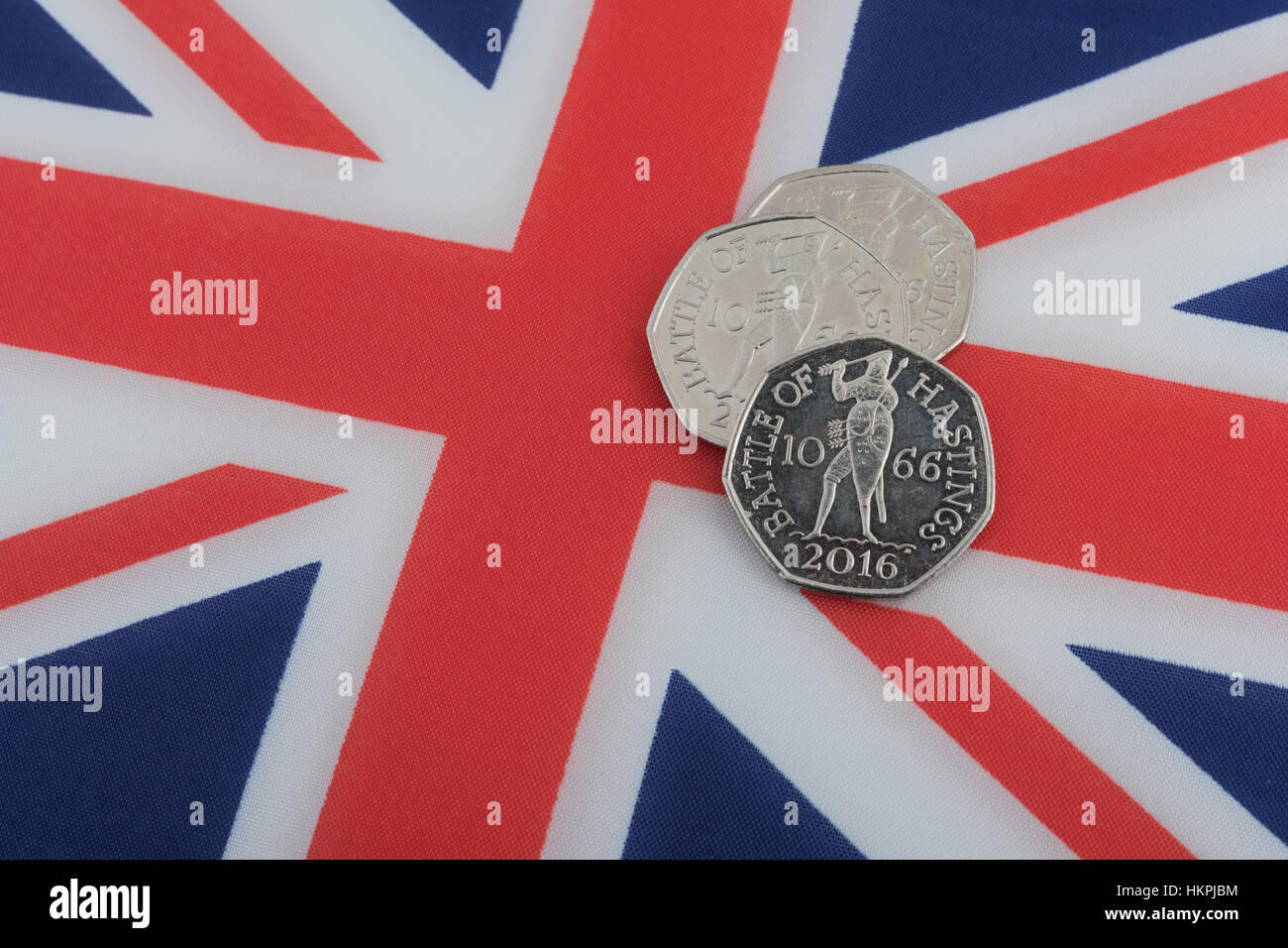 Three Battle of Hastings 1066 50 pence, 50p, pieces on a Union Jack. - Stock Image