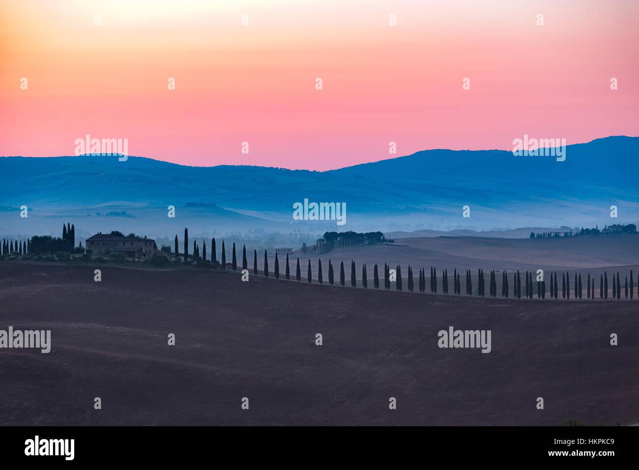 Farmhouse with cypress, Val d'Orcia, Tuscany, Italy Stock Photo