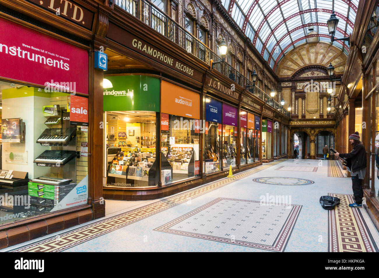 A busker in the Central Arcade, Newcastle.  The arcade was built in 1906 & designed by the Newcastle firm of - Stock Image
