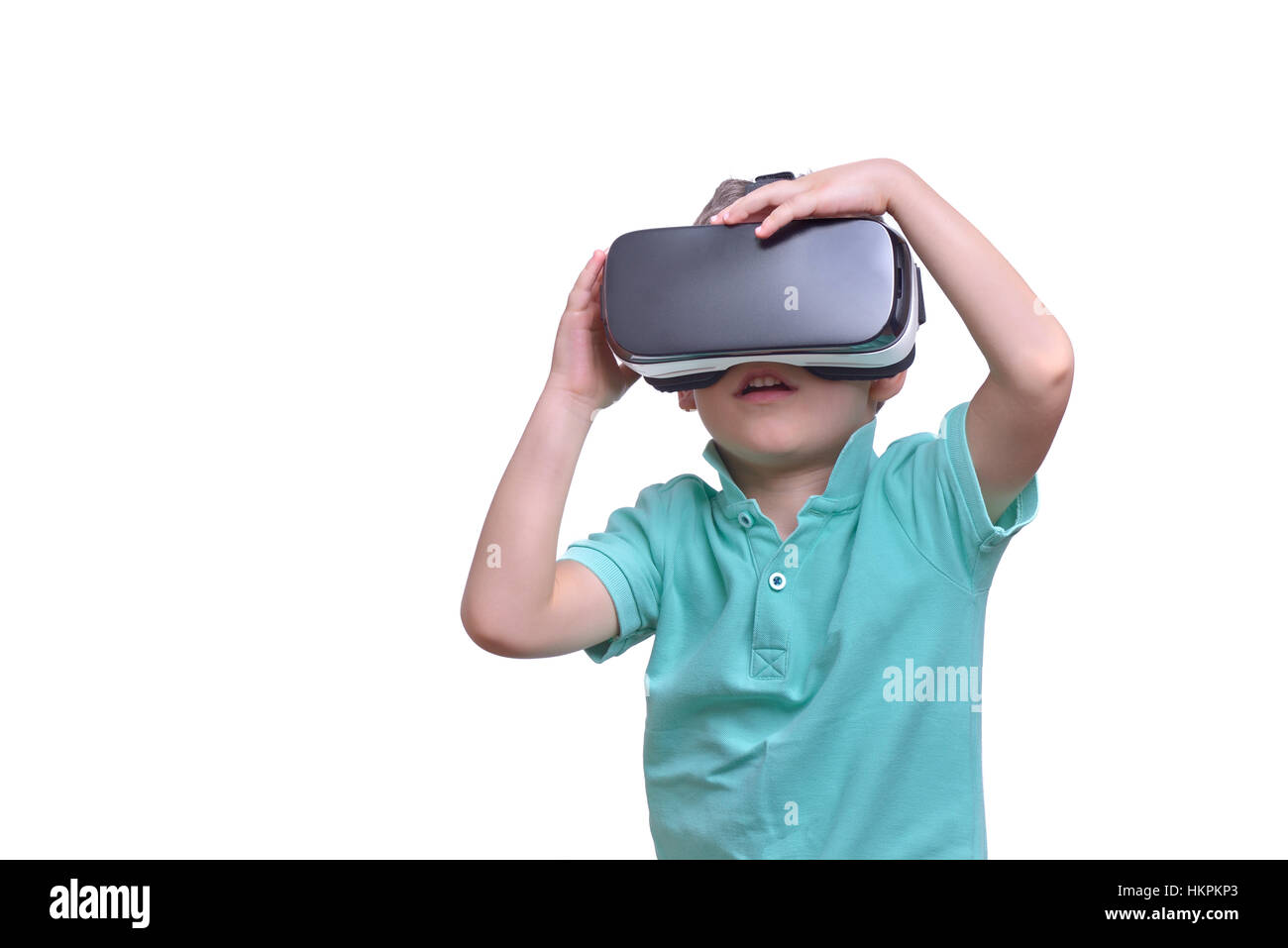 Amazed Teen Boy Wearing Virtual Reality Stock Photo (Edit