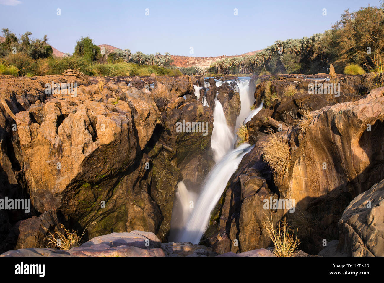 Epupa Waterfalls, also known as Monte Negro Falls, Kunene River, Kaokoland, Namibia, by Monika Hrdinova/Dembinsky - Stock Image