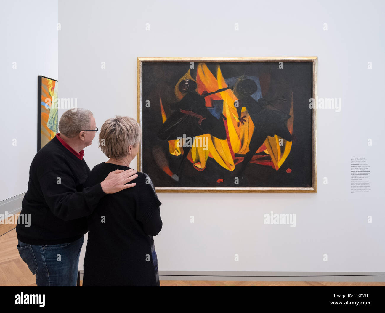 Visitor looking at painting, Children Playing With Fire by Rufino Tamayo at new Museum Barberini in Potsdam Germany - Stock Image