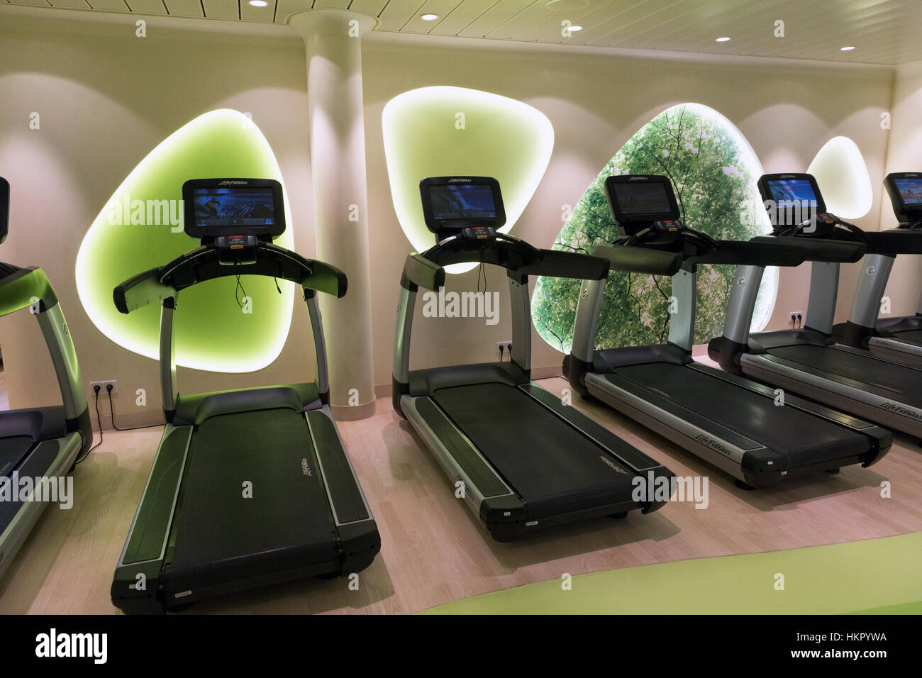 ROTTERDAM - NOV 24, 2016: Row of treadmills in the fitness center on board of the AIDAprima cruise ship. - Stock Image