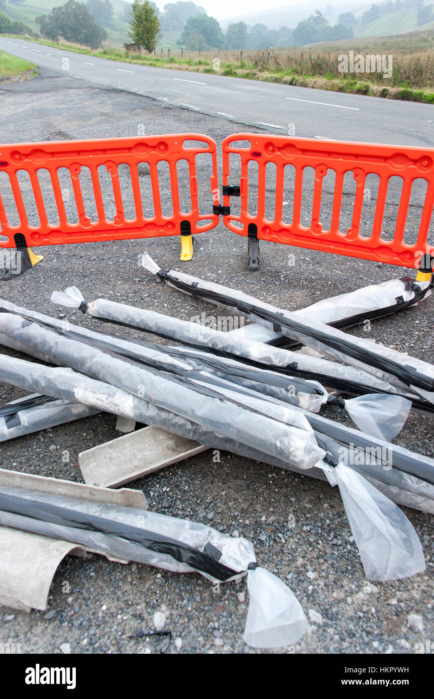 Asbestos material dumped illegally in a roadside laybye, Cumbria, UK. - Stock Image