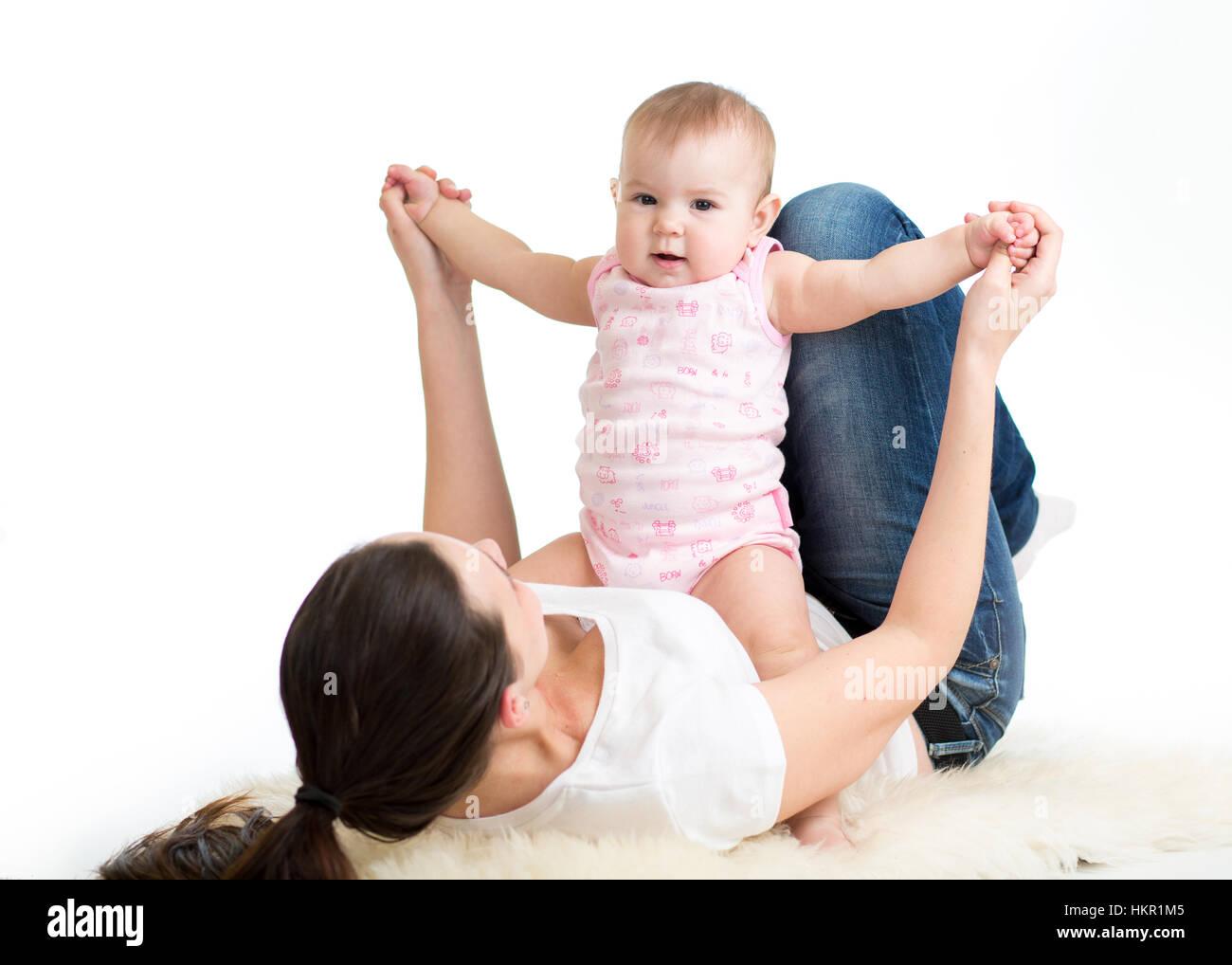 Mother and baby gymnastics, yoga exercises - Stock Image